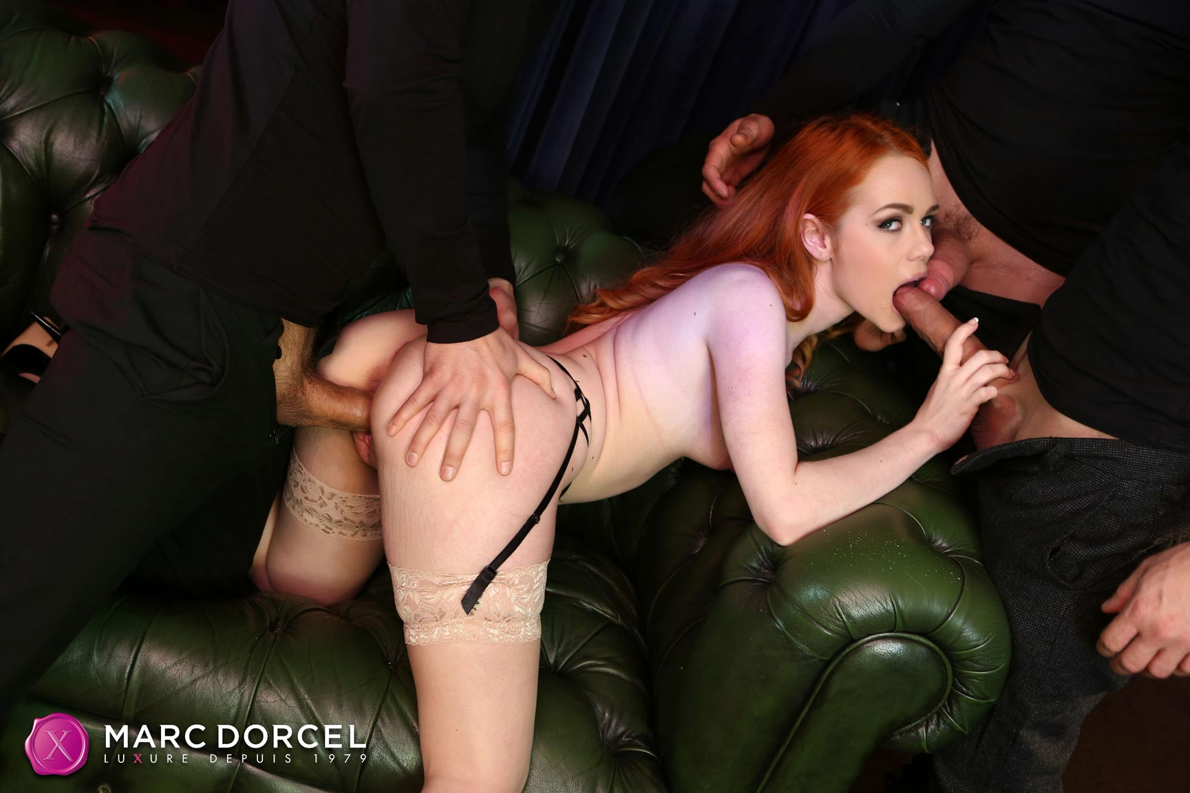 Gorgeous stocking redhead with tiny tits in a wild gangbang scene.
